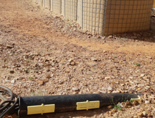 Split pipe cable protection at military base